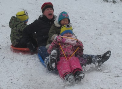 Stuyvesant Town residents like Katie Freeborn and her kids took advantage of a day off from school by going sledding on the 20th Street Loop. (Photo by Maria Rocha-Buschel)