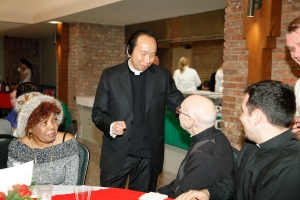 Father Buu at a reception in his honor