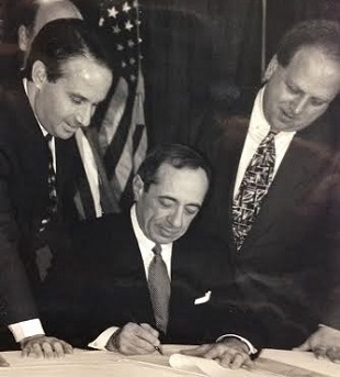 In November, 1993, Governor Mario Cuomo signed a bill into law that created a new $210M  program for mental health services by redirecting savings from psychiatric hospitals that were closing and creating a network of local programs. (Pictured with Cuomo are Sanders, the bill's author, and State Senator Nick Spano.)