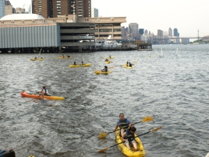 Kayakers fill the East River by Stuyvesant Cove Park during an event last June. (Photo by Maria Rocha-Buschel)