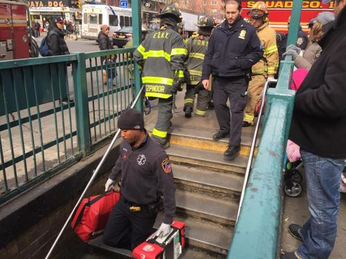Emergency personnel head into the First Avenue L station. (Photo by Sabina Mollot)