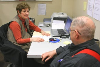 A volunteer helps a client at an FCC center.