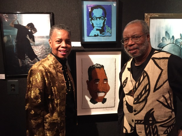 East Midtown Plaza residents Shelley and Claude Winfield stand by Claude's portraits of Duke Ellington and John Coltrane, which were made out of beads.