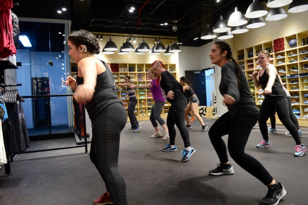 Michele Gordon (far left) leads a cardio workout at Reebok FitHub held last Friday. (Photo by Steve Jackson)