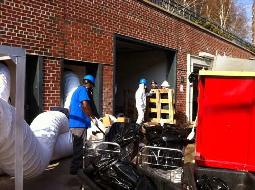 Workers clean out an Avenue C garage in November, 2012 (Photo by Sabina Mollot)