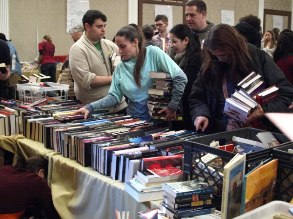 Teachers pick out books for their schools on March 7 after a book drive was conducted at Brotherhood Synagogue and other locations. (Photo by Maria Rocha-Buschel)