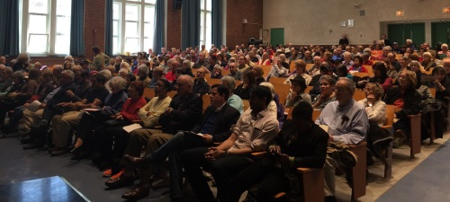Over 400 people listen as local state elected officials brief them on the uphill battle over the rent laws coming in June. (Photo by Sabina Mollot)