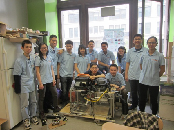 The Baruch InvenTeam with their prototype (left to right) Ivan Chang, Carmen Li, Kevin Zhang, Long Wang Lin, Wendy Ni, Xiao Hui Zheng, Conan Lin, Sherry Ou Yang, William Chung and Queena Chiu (behind the prototype, left to right) Elton Zhang and Tony Long (Photo by Maria Rocha-Buschel)
