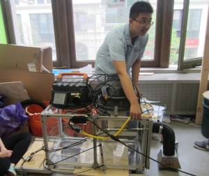 Xiao Hui Zheng demonstrates how the light sensors work on the prototype.