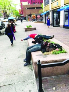 Three men sleep on top of a planter located on Third Avenue between 31st and 32nd Streets in a recent photo snapped by a neighborhood resident.