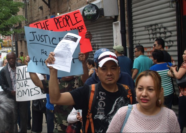Residents demonstrated outside their building last Thursday to protest aggressive buyout tactics and other ways they say the landlord is harassing them. (Photos by Maria Rocha-Buschel)