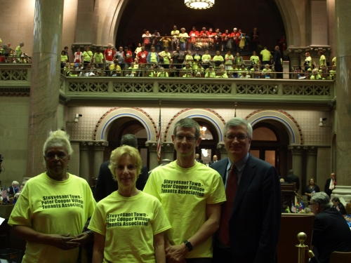 Around 150 residents of Stuyvesant Town/Peter Cooper Village along with tenants from other communities headed to Albany on Tuesday to call for stronger rent laws. (Pictured) Tenants Association Chair Susan Steinberg and President John Marsh with another resident (left) and Assembly Member Brian Kavanagh on the Assembly floor (Photo by Maria Rocha Buschel)