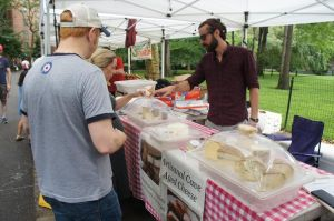 Pablo Navas helps customers at the Stuyvesant Town market. (Photo by Kaley Pillinger)