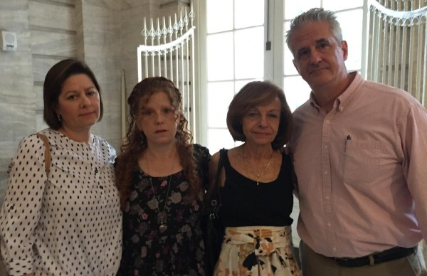 The Chanko family at City Hall in July: Barbara, wife of Mark Chanko's son Kenneth (right), Mark's daughter Pamela and his widow Anita (Photo by Sabina Mollot)