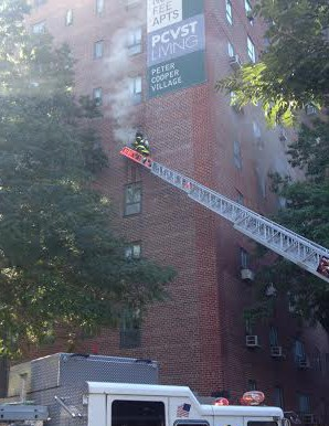 A firefighter gets ready to enter a fourth floor apartment at 601 East 20th Street. Photo via FDNY)