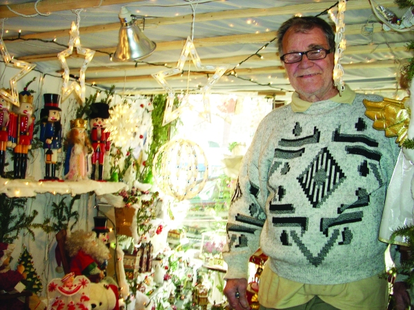 William Koniuk at The Frenchmen store next to part of its Christmas display (Photo by Sabina Mollot)