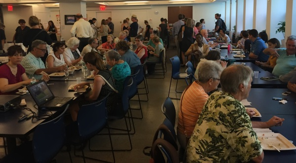 Those in attendance at the  meeting last Tuesday sat at tables while the pros and cons of each option for the project were discussed. (Pictured) Guests seated before the presentation began (Photo by Maria Rocha-Buschel)