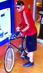 Surveillance image of suspect who allegedly robbed Ponce de Leon on First Avenue and also tried to rob other banks