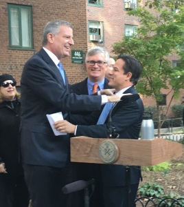 Mayor Bill de Blasio and Council Member Dan Garodnick hug at the press conference. (Photo by Sabina Mollot)
