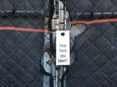 Door knob sign by Linda Hesh at Avenue A construction site