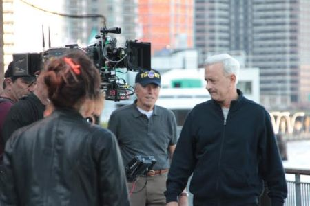 "Clint Eastwood directed a newly white-haired Tom Hanks in a scene for ""Sully"" about heroic pilot Chesley ""Sully"" Sullenberger at Waterside last Wednesday. (Photo via Waterside Plaza blog)"