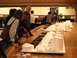 Meeting attendees in 2015 look at a model of Stuyvesant Town and Peter Cooper Village with a planned elevated park at the waterfront. (Photo by Maria Rocha-Buschel)