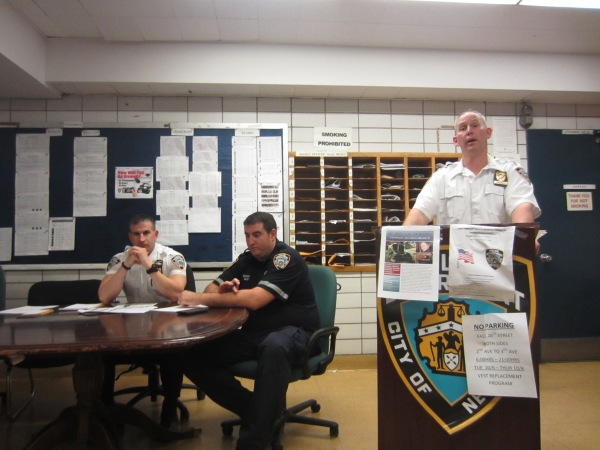 Deputy Inspector Brendan Timoney giving crime stats at the meeting (Photos by Maria Rocha-Buschel)