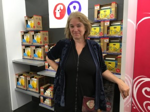 Carole Husiak by the Fisher-Price revival toy display (Photo by Sabina Mollot)