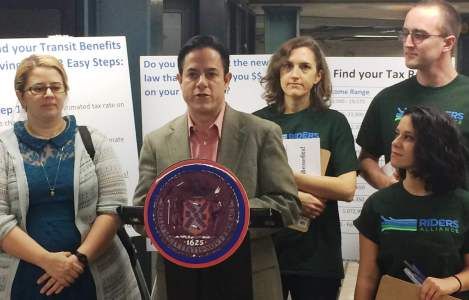 Council Member Dan Garodnick speaks at an event in Union Square to promote the Community Benefits Law, which will save commuters an average of $443 a year in monthly MetroCards. (Photo courtesy of Riders Alliance)