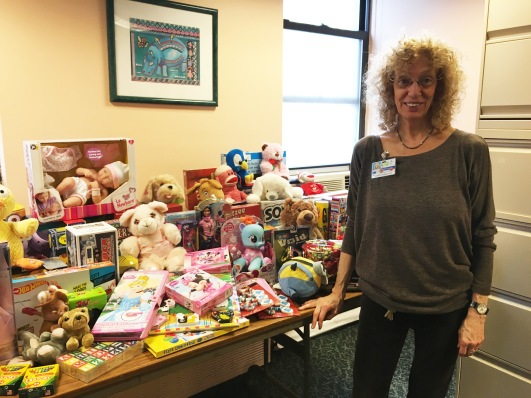 Mount Sinai Beth Israel's Dr. Bonnie Robbins, coordinator of children and family services, with some of the toys at her office. (Photo by Sabina Mollot)