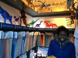Sales rep Natasha Lear with some of the dinosaur puzzles at Boneyard Pets