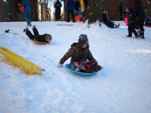 Kids sled from the top of the hill on the 20th Street Loop