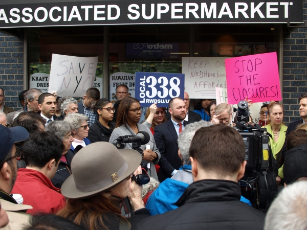 Customers and elected officials attend a rally in support of the supermarket at West 14th Street. (Photo by Maria Rocha-Buschel)