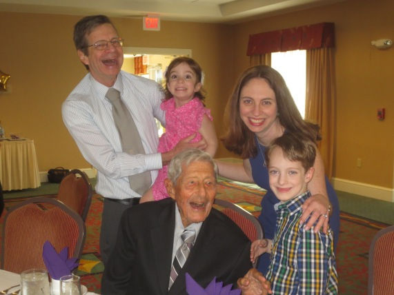 Joseph LoMenzo (center) celebrates his 100th birthday with son, his granddaughter and her children.