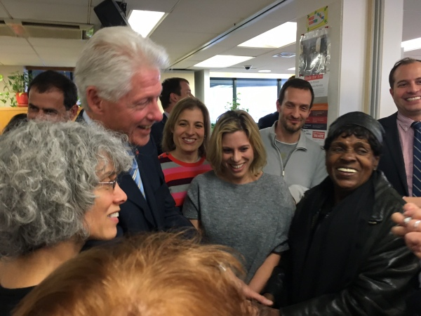 Clinton laughing with tenants