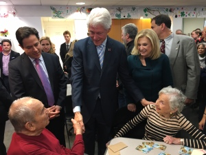 Former President Clinton, with Council Member Dan Garodnick and Congresswoman Maloney, greets residents at the community center. (Photo by Sabina Mollot)