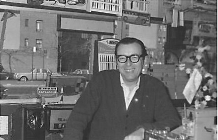 The owner of Jo-Jo's, Harry Dugatkin, also known as Heshie, also known as Star, behind the counter at his store