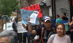 Tenants protest outside a Toledano-owned building on East 13th Street last June. (Photo by Maria Rocha-Buschel)