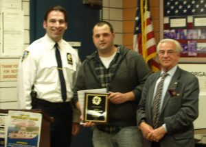Lieutenant Bekim Kalicovic with Cop of the Month Officer Eric Demery and Frank Scala, president of the 13th Precinct Community Council