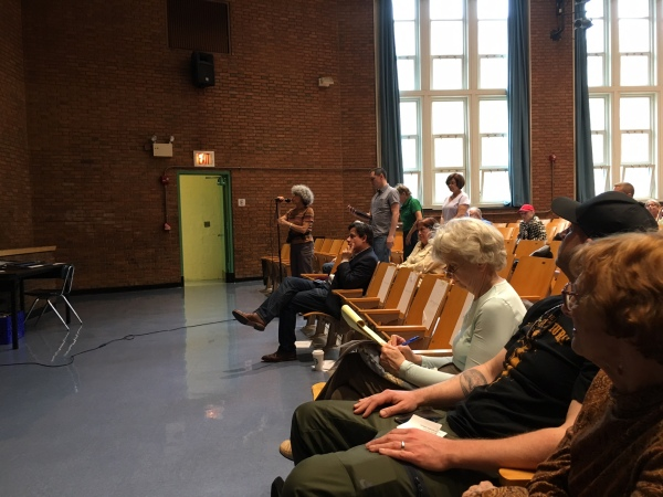 Residents ask questions at the meeting, which was attended by around 100 people. (Photos by Sabina Mollot)