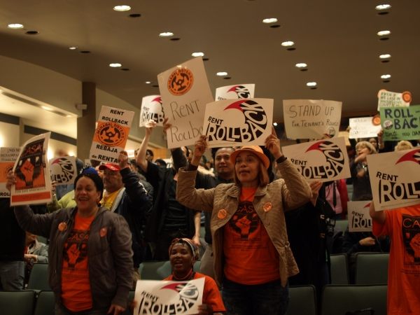 Tenant activists  interrupt the Rent Guidelines Board meeting to demand a rollback. (Photo by Maria Rocha-Buschel)