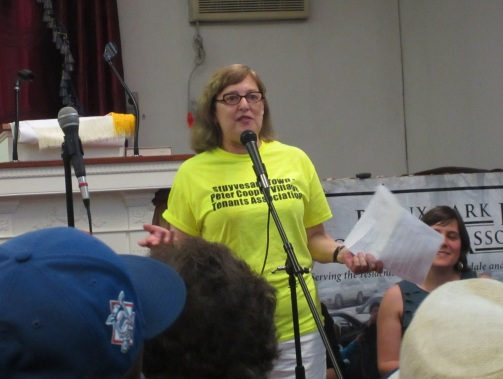 Stuyvesant Town-Peter Cooper Village Tenants Association Board Member Anne Greenberg speaks at the Bronx event, alongside other tenant activists from around the city. (Photo by  Maria Rocha-Buschel)