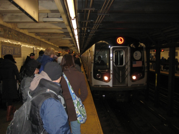 Straphangers waiting for the L at First Ave. (Photo by Sabina Mollot)