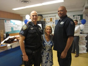 Arlene Harrison with Sergeant Doug Walden and Detective Chris Williams from the Emergency Service Unit