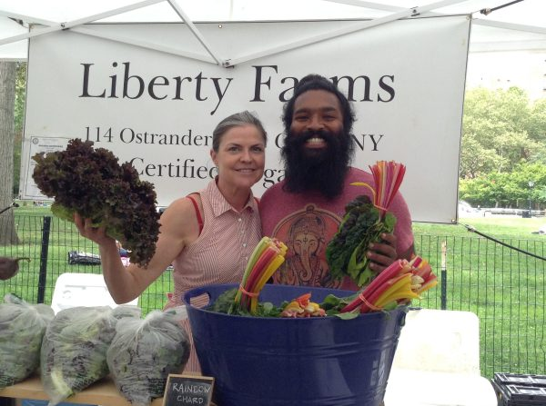 Joseph Koovalloor, pictured with another farmer, of Liberty Farms in Stuyvesant Town Photo by Maya Rader)