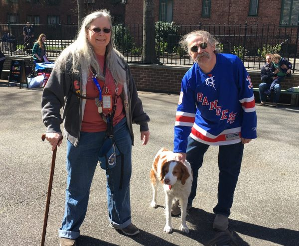 Cheryl Krist with her husband Joseph and disability dog Bocci, pictured at a Dog Days event in Stuyvesant Town in April Photo by Sabina Mollot)