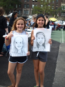 Stuy Town resident Avery Sesny and Gramercy resident Kaitlin Gillon with their caricatures