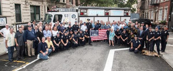 Officers of Emergency Service Truck #1, the 13th Precinct, the K9 unit and NYPD retirees who returned for the WTC Remembrance Ceremony along with Gramercy Park Block Association President Arlene Harrison in front of the 13th Precinct on East 21st Street (Photo by William Baker/Courtesy of the PBA of the NYPD)