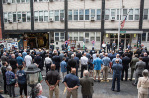 The NYPD and members of the community in front of the 13th Precinct on Sunday (Photo by William Baker/Courtesy of the PBA of the NYPD)