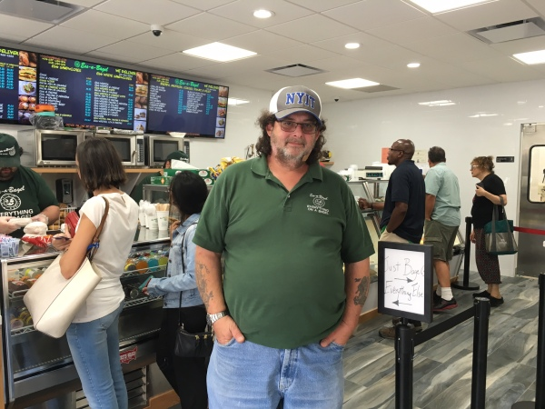 Co-owner Mike Wenzelberg at the new shop in Stuyvesant Town (Photo by Sabina Mollot)
